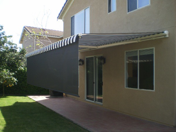 Home with retractable awning in back yard